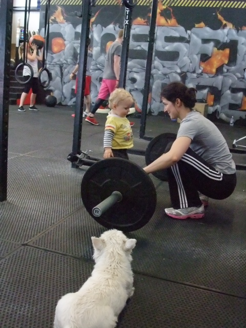 Violaine and son in the gym